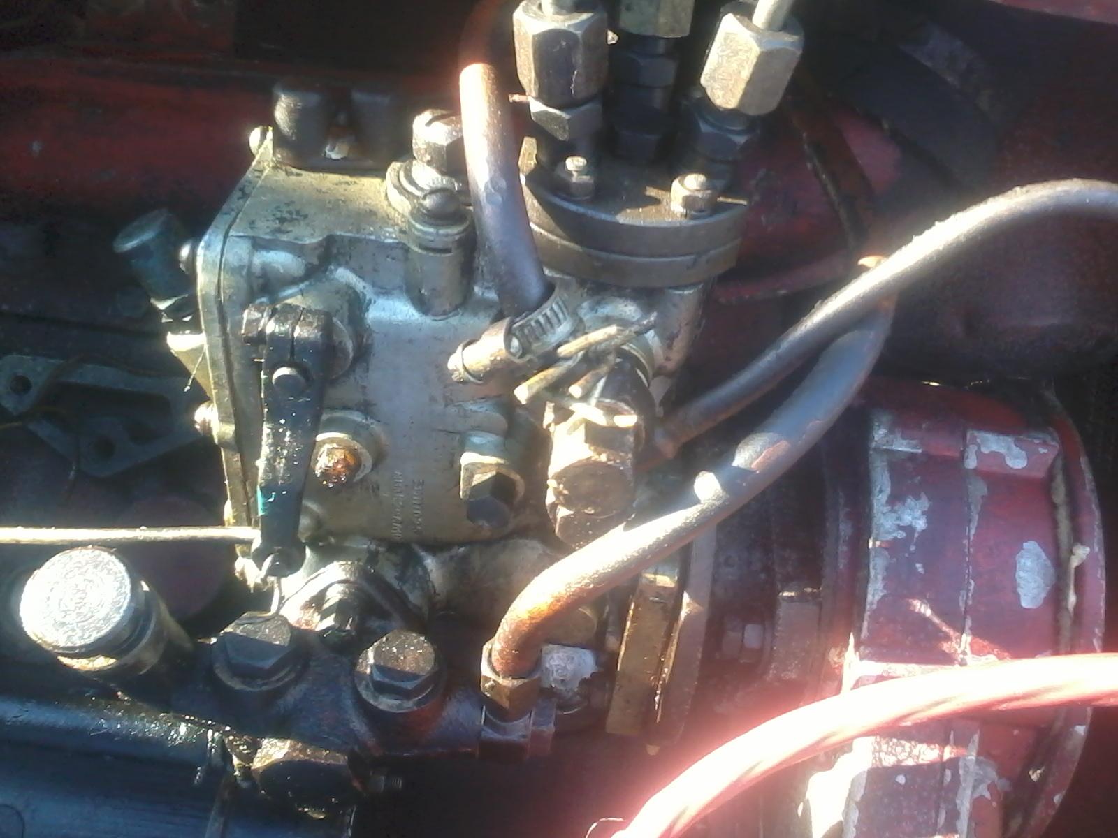 купить топливный насос на трактор универсал445